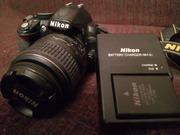 Продаю Nikon D3100 с зарядкой в отличном состоянии